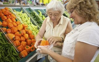 Woman Grocery Shopping with Senior